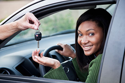 image of young girl getting keys to her first car