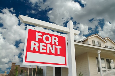 image of for rent sign in front of a house