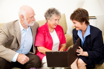 image of insurance rep talking to couple