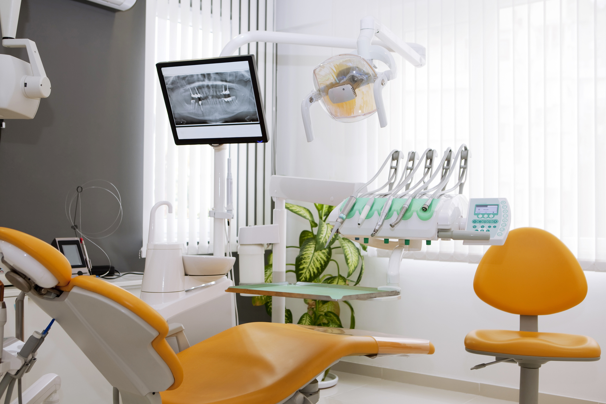 Image of the inside of a dentist office with equipment